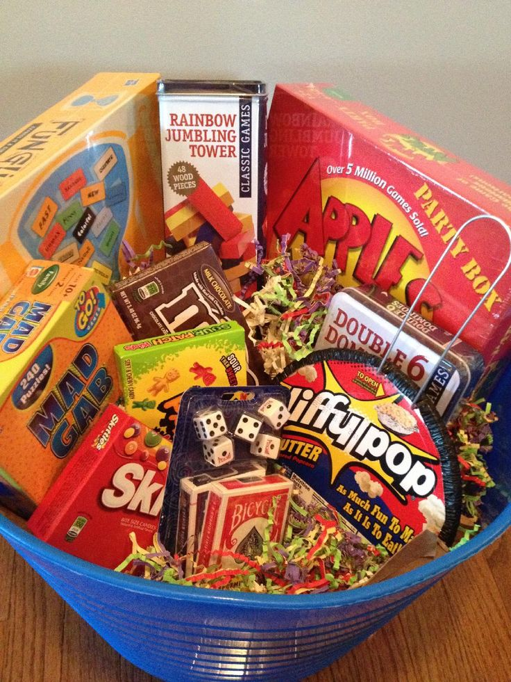 Family Game Night Gift Basket: Games, candy, popcorn. For a family gift.