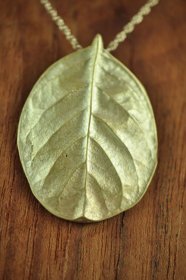 Bright large bronze salal pendant. Salal, a symbol of prosperity, boasts a beautiful leaf that has been captured here in its complete pureness. $145