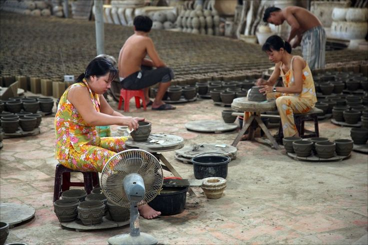 Just look at all those pots! Now that is Production!  Pottery wheel in use at Mekong Delta factory - Declan McCullagh Photo