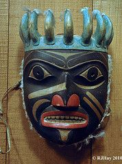 Haida Mask - A Shaman's mask of red cedar with eagle down.    Museum of Civilization   by Ron Hay