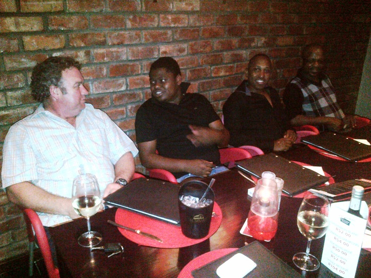 Hanno, Gregory, Tony and Sam enjoying a well-deserved meal.