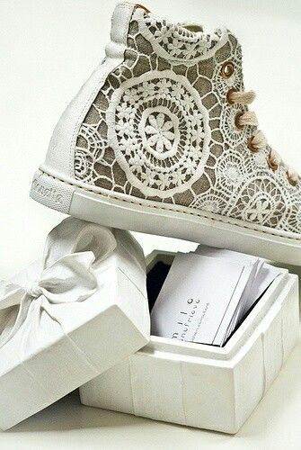 Love these Lace hightop converse shoe, I'd wear these as a wedding shoe as an alternative to heels.
