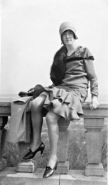 A lady identified as Miss Grant sitting on a balustrade, Mount Royal Lookout, Montreal, QC, 1929. #vintage #Canada #1920s #fashion
