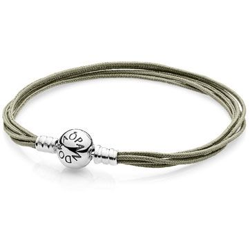 Multi-Strand Khaki Cord Bracelet - Add an organic touch if color to your collection and represent your natural style. This sterling silver, five-strand, khaki fabric bracelet is a light and delicate way to highlight your favorite charms.