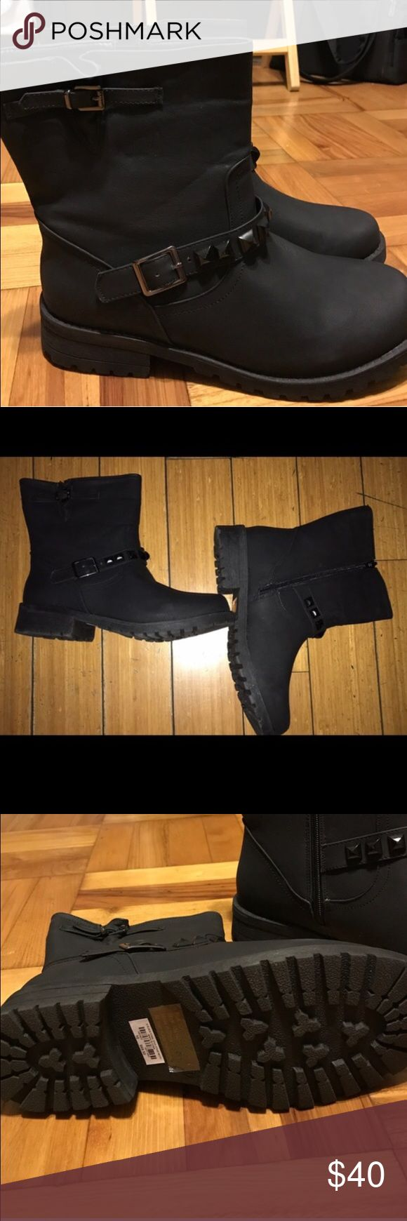 Black Moto Wide Ankle Boots BRAND NEW. NEVER WORN. They didn't fit! I guess I needed a 10.5. Inside zipper goes all the way down. Black matte color. Strong grip soles. Perfect for rain. Cool studded strap! torrid Shoes Ankle Boots & Booties