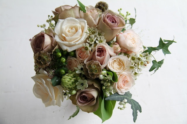 Vendella, Quick Sand & Amnesia Roses, Gracia Crème & Bombastic Floribunda Roses, Lily of the Valley, Scabious Seed Heads, Black Dille, Wax Flower Blossom, Arabicum Chincherinchee, Green Hypericum, Champagne Grass and Ivy