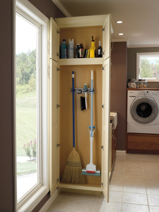 Cleaning supplies, mop, broom and dustpan storage.