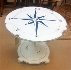 Nautical compass table at Coastal home and Garden llc-this could be an easy DIY. I could handle one piece of shabby chic in the living room-This would also be great on the headboard --yes yes