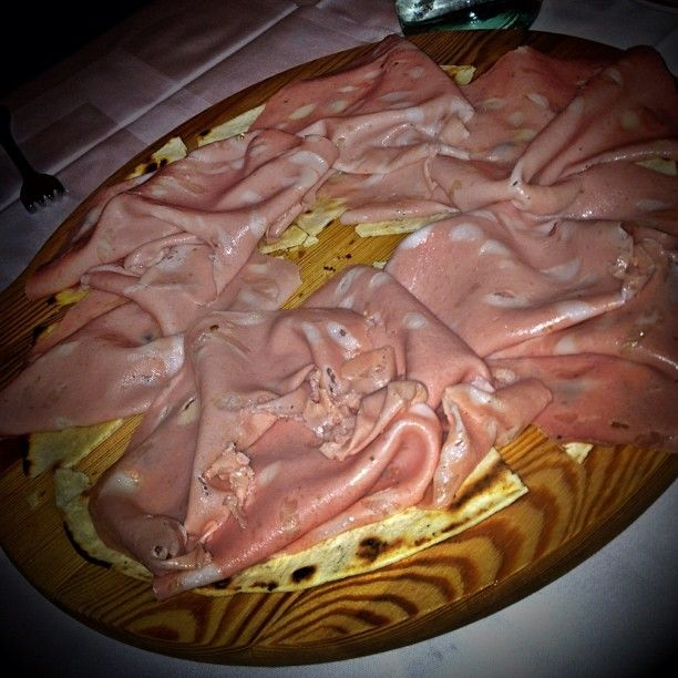 Two Emilia Romagna specialties: mortadella from Bologna & piadina from Riccione - Instagram by @poohstraveler