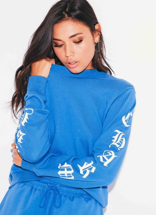 Welcome to Sydneys newest nostalgic label, Beyond Her. Designed by Amy Badikovich who throws us back to the 90s with her first collection that makes us dream of feminine vintage summers.  Lucky Charm Jumper - Blue