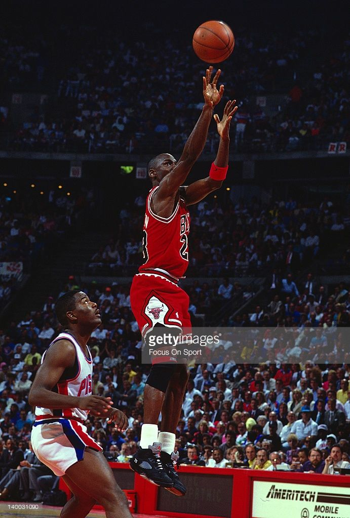 Michael Jordan #23 of the Chicago Bulls shoots over Joe Dumars #4 of the Detroit Pistons during an NBA basketball game circa 1989 at The Palace at Auburn Hills in Auburn Hills, Michigan. Jordan played for the Bulls from 1984-93 and 1995 - 98.