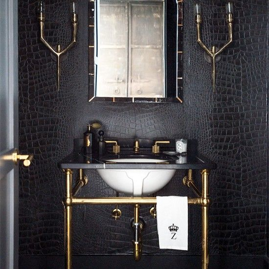 Dramatic bathroom - gold fixtures and black crocodile skin patterned wallpaper