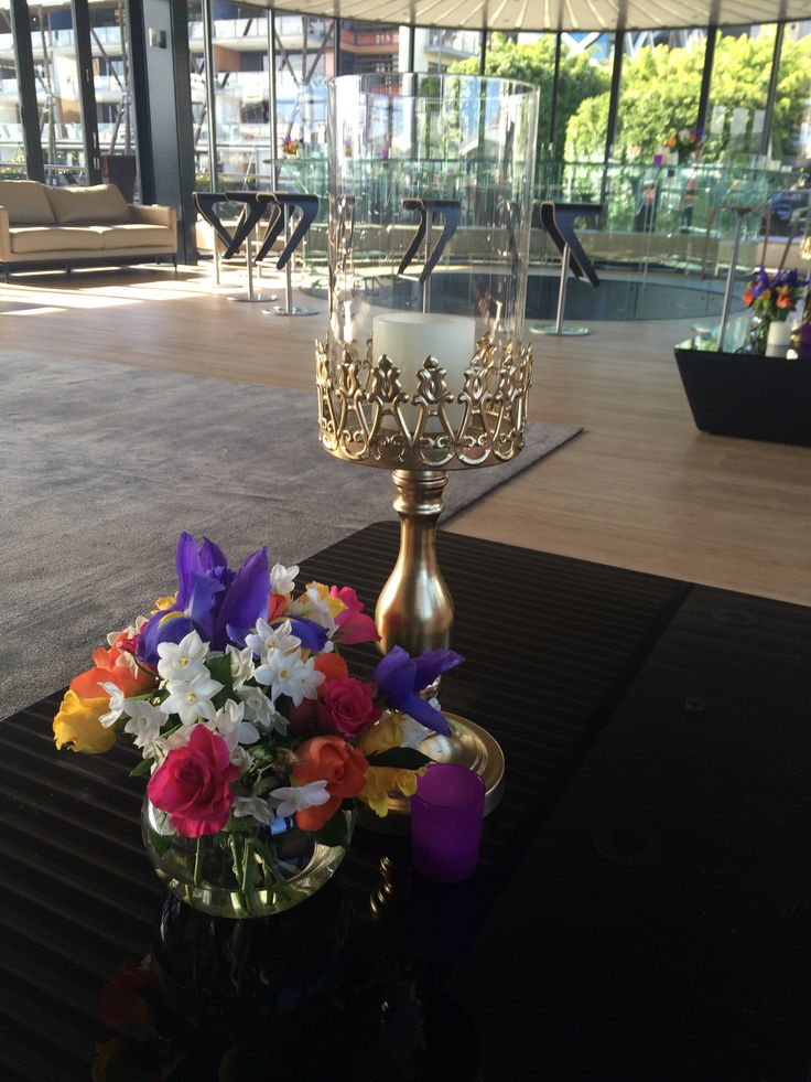 Middle Level Accessorising Gold Hurricanes Bright floral centrepieces Purple Tea Light Votives http://www.bespokesocial.com.au/ http://www.starshipsydney.com.au/
