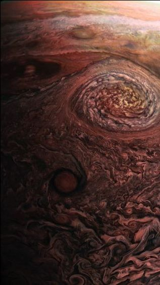 New photo of Jupiter and its Great Red Spot. From just 5,600 miles away, NASA's Juno mission offers a new look at the planet's famous Great Red Spot storm and also the swirl of hurricanes in Juno's Eye. These photos were taken on July 10, 2017. Image credit: NASA / SwRI / MSSS.