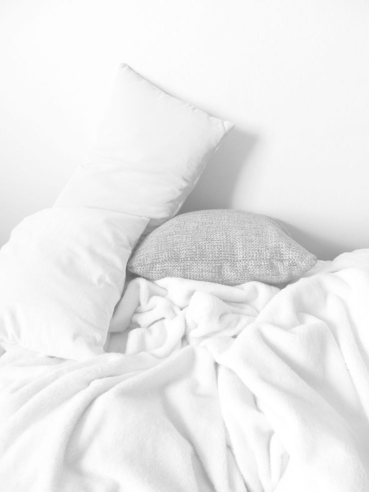 White, cozy blankets and pillows in bed