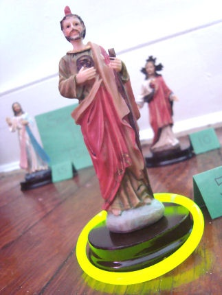 Canonize the Saints:  use small statues glued to floor or poster board   and   glow in the dark bracelets.  Can also use soda bottles with saint pix taped to them.