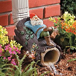 Gnome resting on a log---downspout extender. From Improvementscatalog.com.