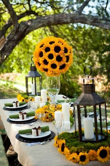 sunflower center pieces - so pretty! like how the vases are tall, it adds a lot to the flowers and table