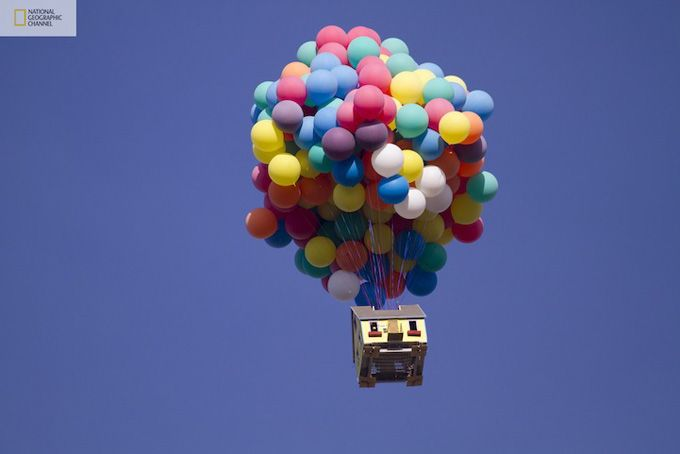 """REAL LIFE """"UP"""" - A team of scientists, engineers, and two world-class balloon pilots successfully launched a 16' X 16' house 18' tall with 8' coloured weather balloons from a private airfield east of Los Angeles, and set a new world record for the largest balloon cluster flight ever attempted."""