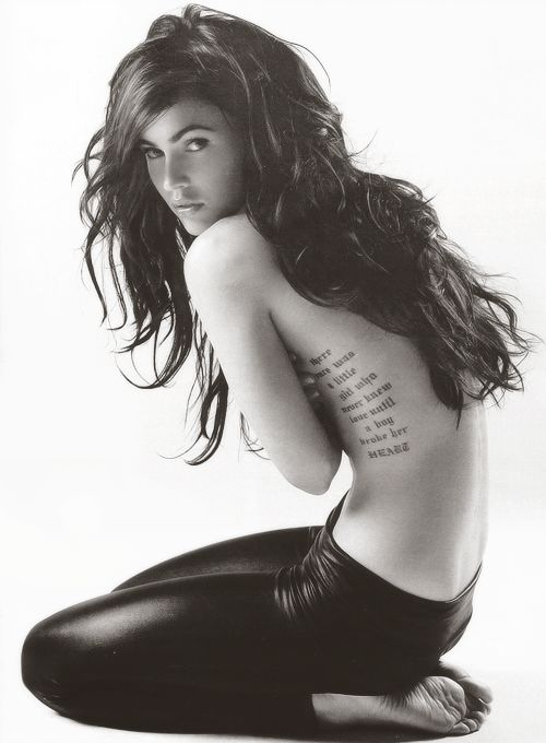 """There once was a little girl who never knew love until a boy broke her heart"" Megan Fox's rib tattoo"