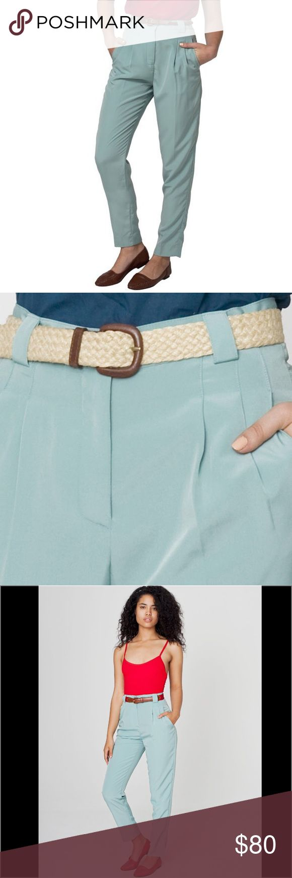 American Apparel Seafoam High-Waist Pleated Pants American Apparel  Size: Small  These comfortable and casual pleated trousers from American Apparel are constructed of smooth, high-end micro-polyester. These pants feature a classic high-waisted design with belt loops for a retro-inspired look. .  •Color: Seafoam •Fit: Trouser •Two (2) side pockets •Belt loops •Zipper fly American Apparel Pants Trousers
