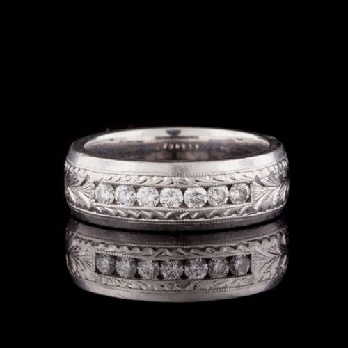 Tacori Platinum & Diamond band that consists of 7 Round Cut Diamonds with a total approximate weight of 0.42cts.  Ring is 7mm in width, weighs 19.9 grams, and is a size 9.25.