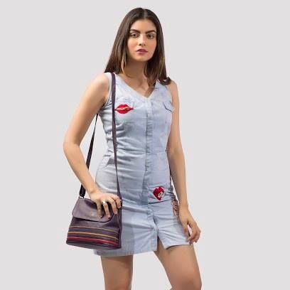 White sneakers, a patchwork shirt dress and a #stripes #slingbag on your shoulder- Go ahead, enjoy flaunting three trends in one look and make a statement like no other. The slingbag is available at any Exclusive Baggit stores or www.baggit.com