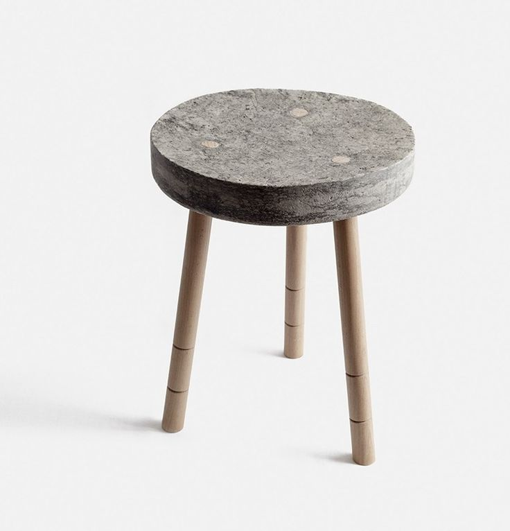 Furniture designer Paula Szwedkowicz combines wooden legs with a paper pulp seat imitable of concrete. Available exclusively from mywarehousehome.com/shop. Photography by Oliver Perrott