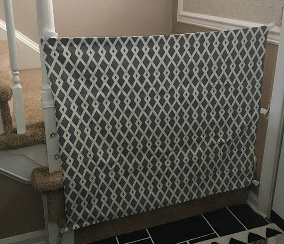Custom made fabric baby gate. This gate keeps pets and children contained and is neutral to match your decor! I love that this gate is temporary and can be removed or folded away when not in use. It is also portable for trips to Grandmas house or anywhere else that needs a little