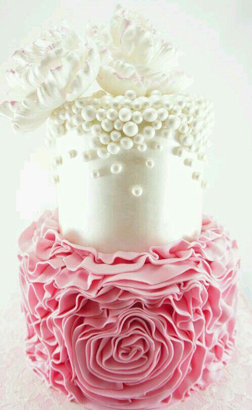 Pink ruffles and white pearls wedding cake.