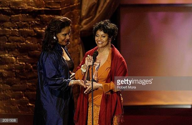 Actress Phylicia Rashad presents an award to sister/producer/director Debbie Allen at the Crystal Lucy Awards celebrated by Women In Film at the...