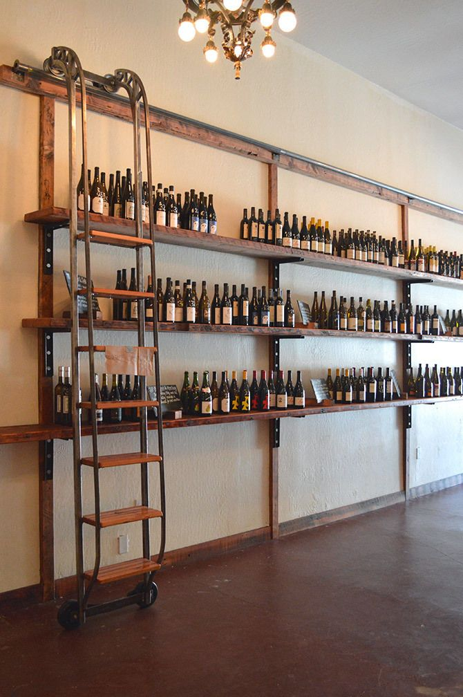 I like the idea of the sliding ladder but would have higher shelves. With the wine options much more organized.