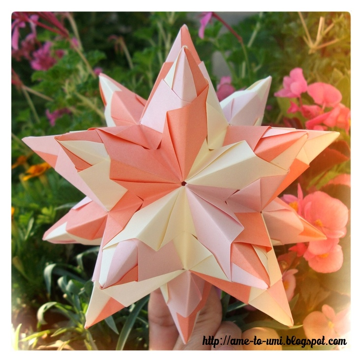 Bascetta Star (apricot, flowery background) made from Paolo Bascetta units, origami, designed by Paolo Bascetta. Stellated icosahedron, 30 pieces, connection: nothing, folded by me.