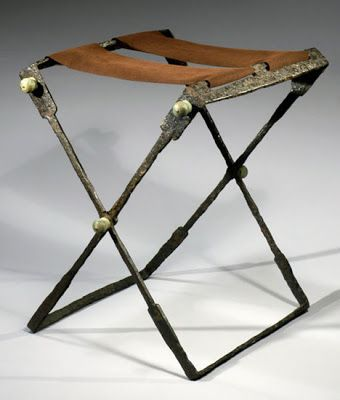A Roman Folding Iron Stool, Seat Replaced.