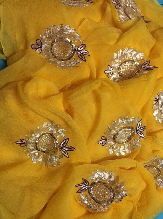 Beautiful yellow saree with hand embroidered motifs. Comes with a running blouse piece.