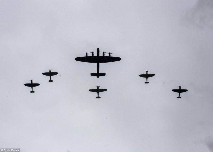 Stirring image: The Lancaster, centre, was accompanied by two Spitfires on both flanks and tailed by a Hurricane