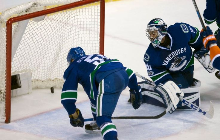 Islanders vs. Canucks:  March 9, 2017  -  The Islanders beat the Vancouver Canucks, 4-3, on Thursday at Rogers Arena:     Vancouver Canucks defenseman Troy Stecher (51) watches as a shot by New York Islanders defenseman Nick Leddy scores past Vancouver Canucks goalie Ryan Miller (30) during the second period of an NHL hockey game Thursday, March 9, 2017, in Vancouver, British Columbia.