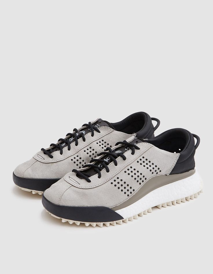 Modern trainer from Adidas in collaboration with Alexander Wang in Grey. Premium synthetic suede upper. Lace-up front with round laces. Perforated neoprene tongue with vintage print. Silicone dotted '3-Stripes' at lateral and medial sides. Leather lining