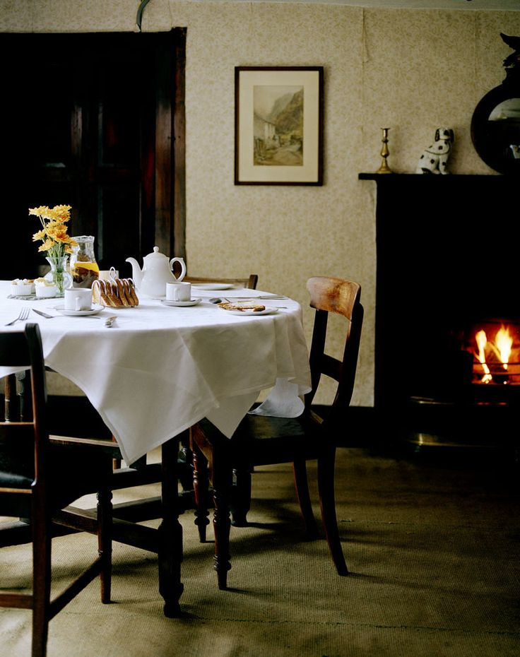A perfect traditional dining room at Yew Tree Farm in Coniston, Cumbria in the Lake District of England, UK. It was owned by Beatrix Potter and still has much of her original decor.