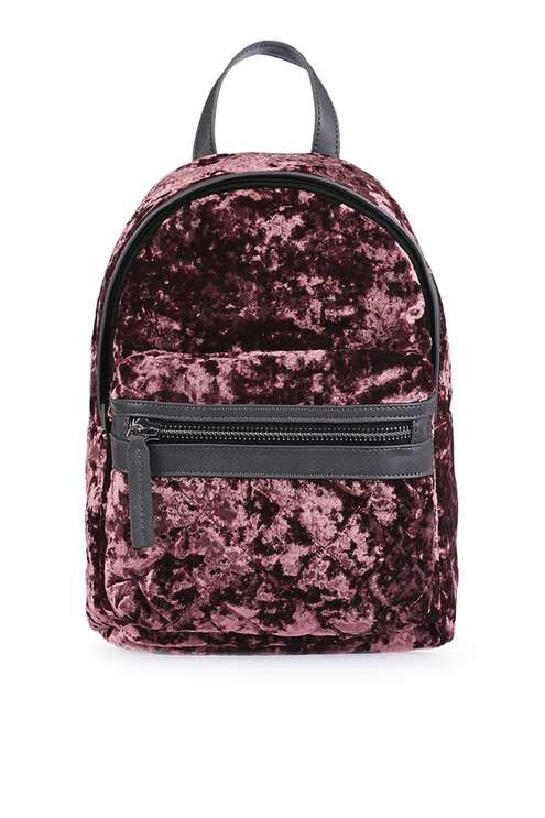 Both ways practical and stylish, the backpack is the trending bag of the season. We love this style in pink velvet with a practical front pocket. A mini size, use this bag to store your main essentials. #Topshop