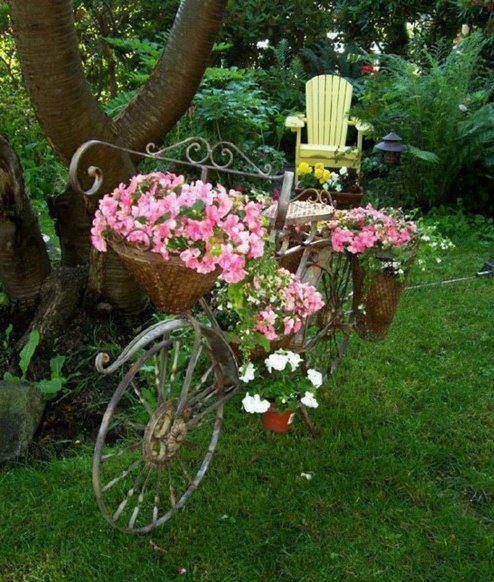 Love this fancy bicycle carrying these beautiful pink flowers and also yellow chair to rest in...maybe just a short nap!!