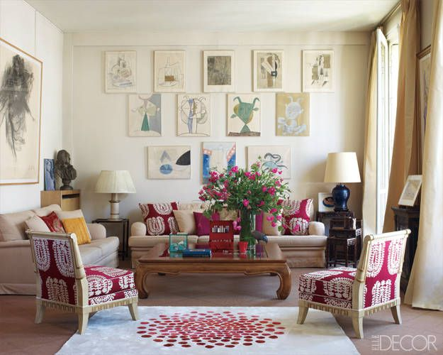 Plates from a book of Picasso works and a drawing by Eric Fischl hang above a pair of custom­made sofas in the living room.