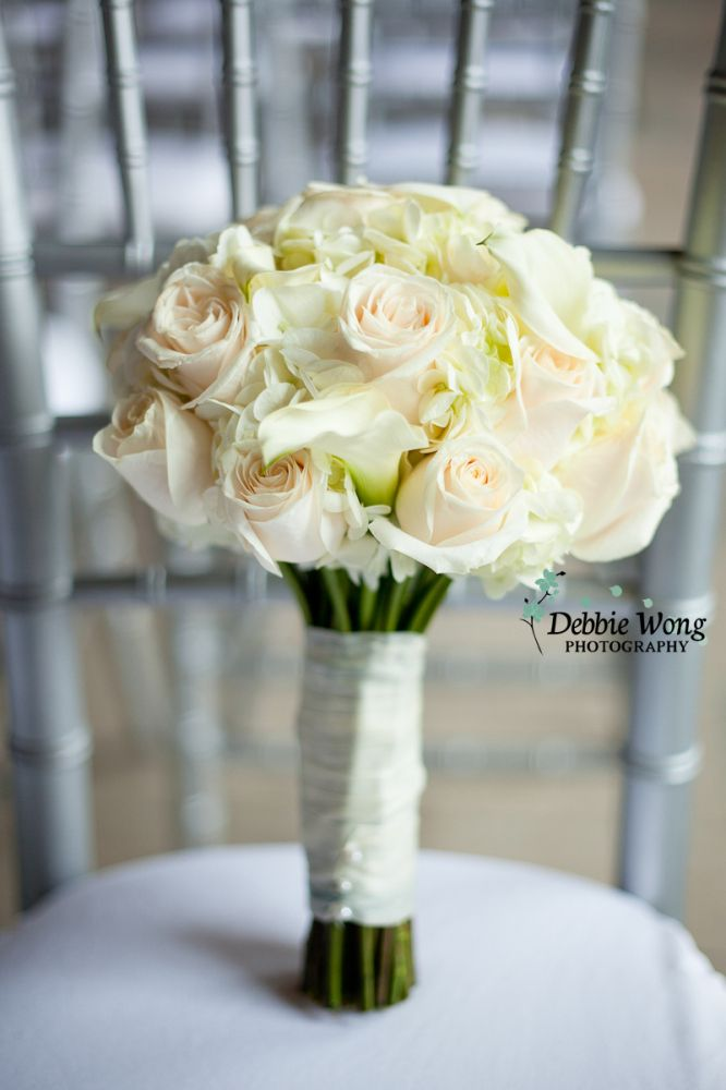 Simple white roses as the bouquet. Debbie Wong Photography, Calgary wedding photography, www.debbiewongphotography.com