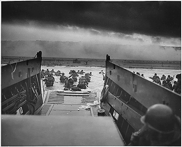 'Into the Jaws of Death' - U.S. Soldiers wade ashore during the D-Day Normandy landings on June 6, 1944.
