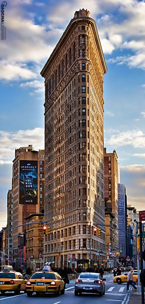 The Flatiron Building was constructed between 1901 and 1903 at the intersection of Broadway and Fifth Avenue, at the time one of the most prominent locations in New York City. It is situated near Madison Square at the end of the Ladies' Mile, one of Manhattan's most important shopping districts.