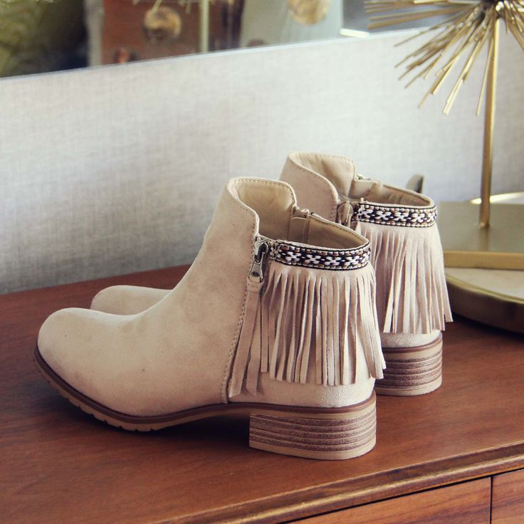 Fringe & boho details adorn these booties. Perfect paired with a bohemian dress. www.spool72.com
