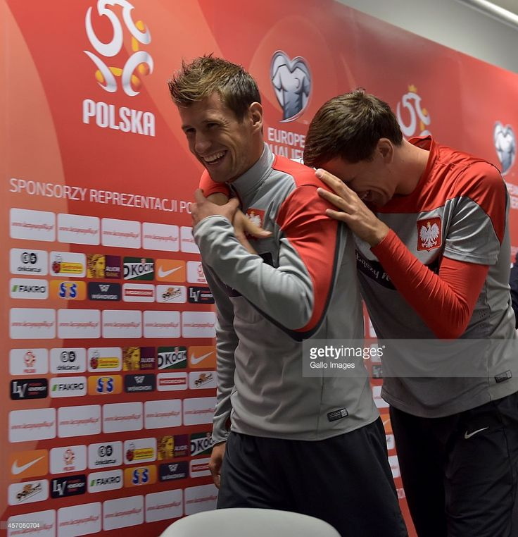 Grzegorz Krychowiak and Wojciech Szczesny during the Poland national soccer team press conference at the National Stadium on October 10, 2014 in Warsaw, Poland.