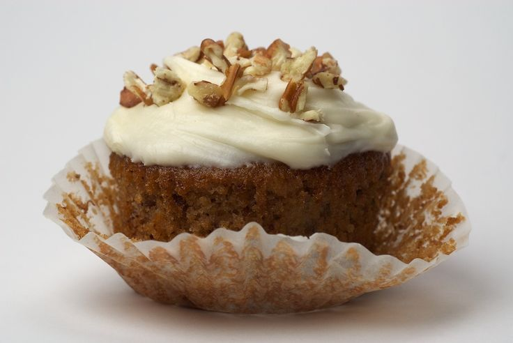 Hummingbird Cupcakes are a delicious combination of bananas, pineapple, nuts, and cinnamon, all topped with cream cheese frosting.