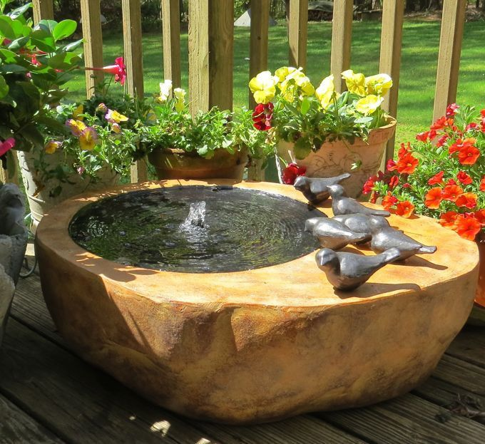 Attract more birds with moving water! Large fountain with natural rock shape and texture features shallow wading and bathing area to entice feathered friends. Generous pool deck area with decorative b