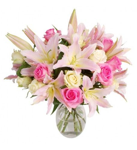 This is a very traditional bouquet which makes one think of days gone by when elegance and style were so in evidence. The beautiful pale pink, scented oriental lilies are complemented by the classic pink and white roses.